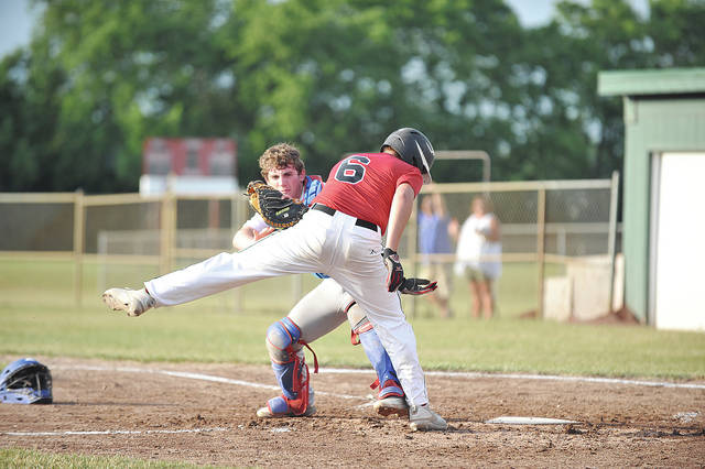 By David Fong | Sidney Daily News Sidney Post 217 catcher Kyle Subler (left) tags out Troy Post 43 runner Trevor Collins Tuesday at Duke Park in Troy.