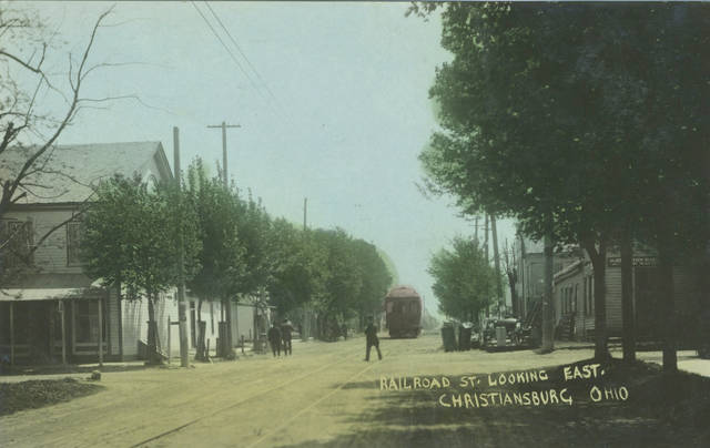 This colorized version of a postcard looking down Railroad Street is dated 1908.