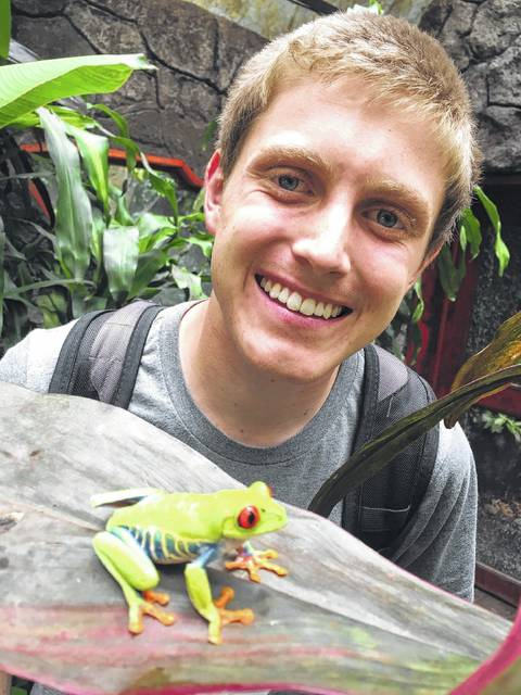 Matt Leach views a tree frog while visiting La Paz Waterfall Gardens in Costa Rica. The gardens, near San Jose, is home to some of the most famous waterfalls in Costa Rica, an animal sanctuary with over 100 species of animals, and an environmental education program. Leach studied Spanish in Costa Rica Jan 3-April 22.