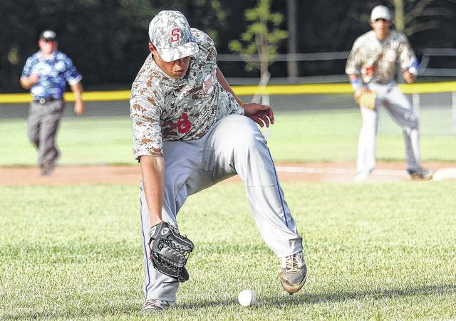 Sidney Post 217 pitcher Elliott Bruns chases down a bunt in the early going against the Dayton Patterson Dodgers in baseball action Wednesday night at Custenborder Field. Sidney won 9-7.