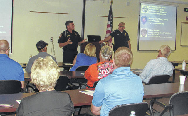 Deputy Chief Marty Grove of Piqua Police Department (left) and Sidney Police Officer Mike McRill (right) instruct an active shooter seminar at the Sidney Police Department, Wednesday morning.
