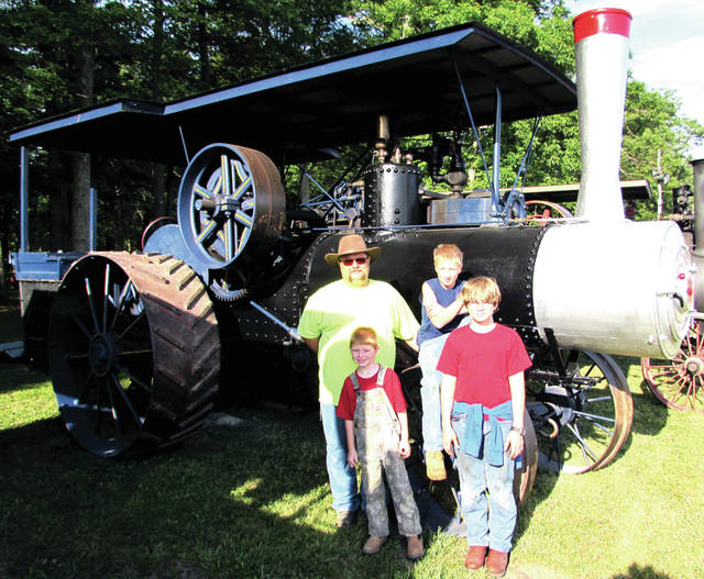 The 61st Annual Reunion of the Darke County Steam Threshers Association Inc. runs through - July 2. Pictured from left (back row): Casey Besecker, his son Troy (front row) cousin Carson and Casey's son Cole in front of Kim's 1925 23- 90 Baker. Kim is Casey's dad.