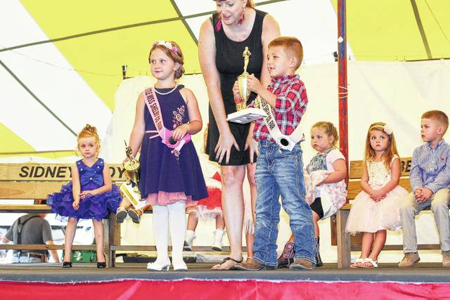 William Heilers, 4, shows off his trophy Sunday night after being named Little Mr Shelby County Fair. Madalynn Woodell, 5, was crowned Little Miss Shelby County Fair. William is the son of Aaron and Sarah Heilers. Madalynn is the daughter of Rob and Misty Woodell.