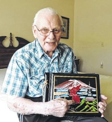 Sharing his picture album of his years in Seoul, Korea, Don Preuter spoke Tuesday to his fellow residents at Elmwood Assisted Living about his experiences as an Army corporal and a carpenter during the Korean War.