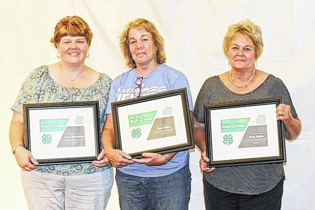 Trena Hershberger, left to right, Barb Heilers and Anita Barker hold their awards after being inducted into the Shelby County 4-H Hall of Fame.