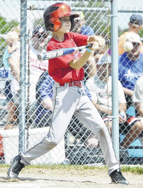 Silas Stiles, 10, of New Knoxville, son of Scott and Jen Stiles, swings during a New Knoxville vs New Bremen little league game at New Knoxville Independence Day, Saturday, July 1.