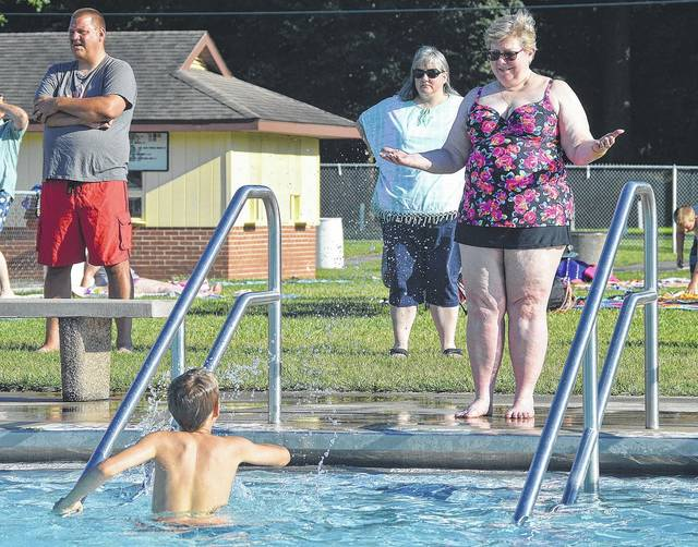 Sidney (United Methodist Church) UMC Children's Pastor Eileen Hix, right, of Sidney, reacts as one of her (Vacation Bible School) VBS students Zebadiah Pleiman, 9, of Anna, son of Dan Pleiman and Betsy and Mike Martin, splashes her with water at the Sidney Municipal Swimming Pool Sunday, July 2. The UMC VBS had a pool party to celebrate the last day of VBS. The theme for this years VBS was Maker Fun Factory.