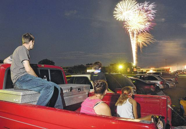 Watching the Sidney 4th of July firewords display are, left to right, Dustin Michael, his son Trevor Michael, 7, wife Christina Michael and daughter Kinzy Micheal, 10, and wife Christina Michael, all of Sidney. The fireworks were sponsored by the city of Sidney, Goffena Furniture, Wilson Health, Emerson Climate Technologies, Buckeye Ford, NK Telco, S&S Hospitality Management and Ferguson Construction Company.