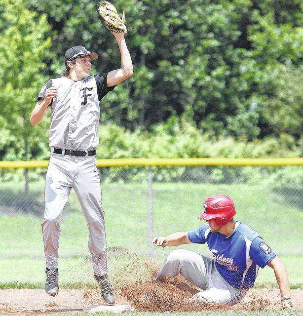 Sidney's Kyle Noble slides into second as Trey Bame comes down with a high throw Saturday.