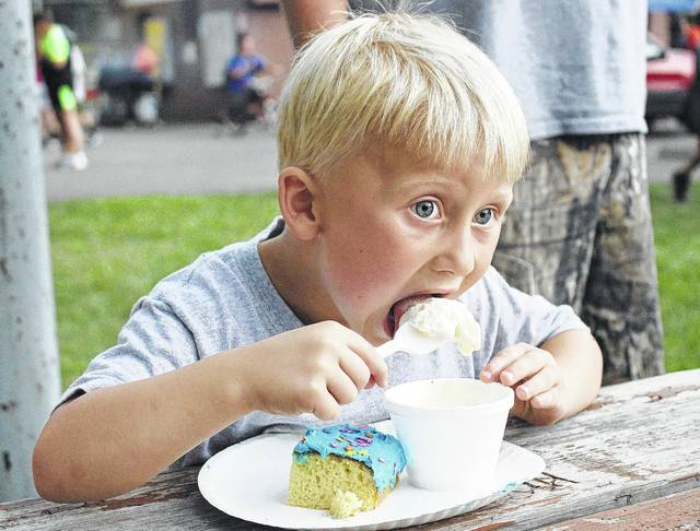 Dustin Hilyard Jr., 4, of Houston, son of Danielle and Dustin Hilyard, eats ice cream and cake at the Iutis Ice Cream Social at Harmon Park Thursday, July 13.