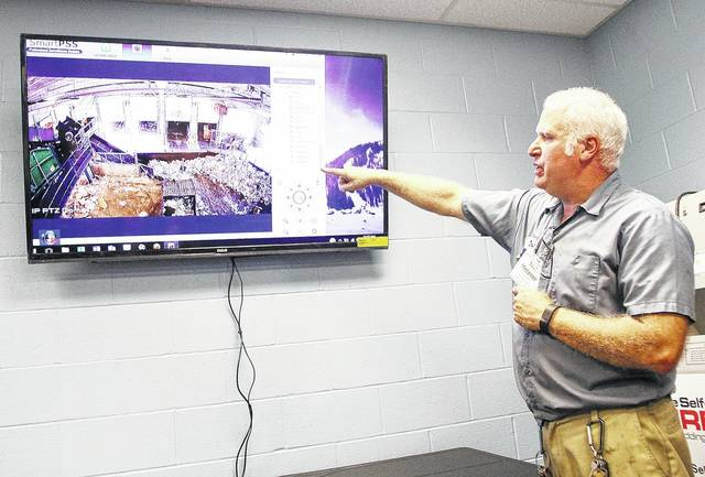 Shelby County Recycling Center Facility Manager Tim Metzner, of Delphos, shows how the Shelby County Recycling Center can be monitored by various video cameras. The same screen can be used to monitor the individual solar modules generating roughly half the facilities energy needs. Metzner was helping give tours of the Shelby County Recycling Center Wednesday, July 19 as part of an open house which highlighted the new solar modules powering the facility.
