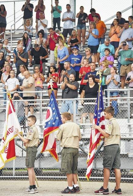 The Boy Scout Troop 97 Color Guard takes part in the Shelby County Fair opening ceremony Sunday, July 23. Making up the color guard are, left to right, Hunter Banfield, 13, of Sidney, son of Matt Holthaus and Elizabeth Banfield, Alex Kellersmith, 12, of Piqua, son of Chad and Cara Kellersmith, and Tommy Sibert, 12, of Sidney, son of Rob and Tara Sibert.
