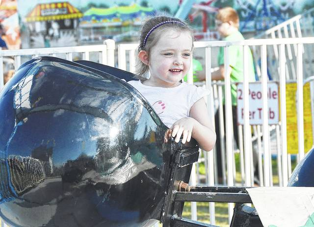 Atalyn Kellem, 4, of Piqua, daughter of Jade Manger and Brice Kellem, rides Willie the Whale at the Shelby County Fair Tuesday, July 25.