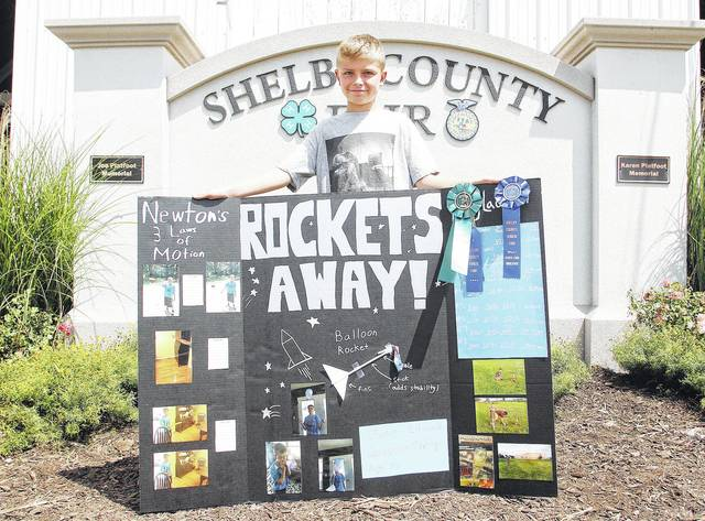 Clayton Edwards, 10, of Sidney, son of Aaron and Kelly Edwards, a member of Scissors to Sheep, won outstanding of the day and state fair qualifier for Rockets Away project at the fair.