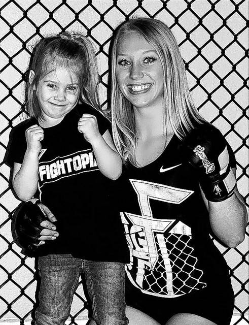 Chelsea Faulder, of Piqua, shown here with her six-year-old daughter, Cheyenne, is set to make her professional debute in Mixed Martial Arts (MMA) competition Saturday.
