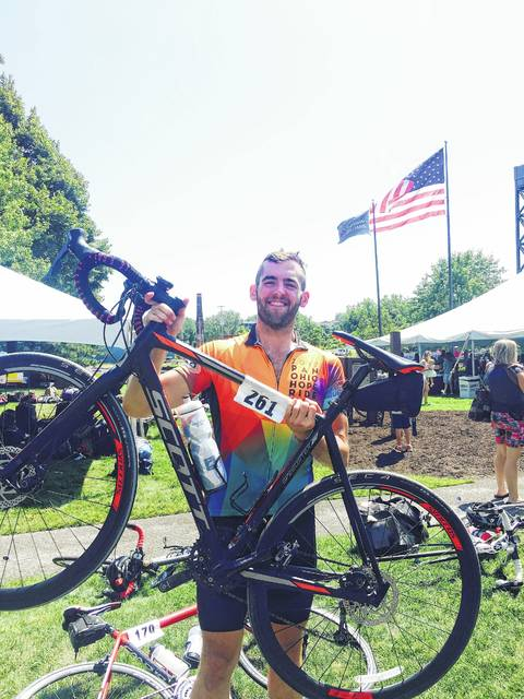 Forest Clayton, formerly of Quincy, poses with the bicycle he rode during during a recent fundraising for the American Cancer Society. He was part of a team that pedaled 328 miles during a four-day trek from Cincinnati to Cleveland recently.