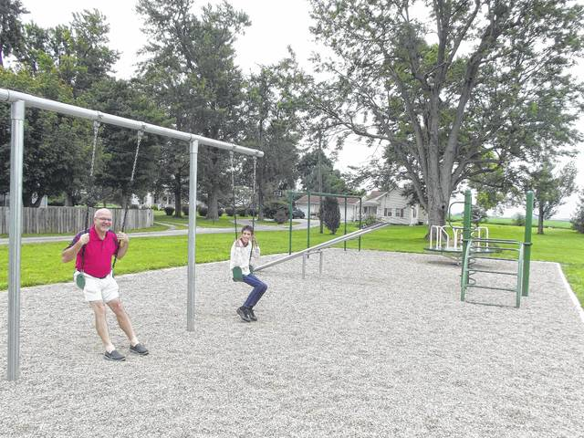 The Rev. Bill Halter and office manager Brenda Baker are all smiles as they get ready to tryout the new swings at the playground at the Maplewood United Methodist Church. A community dedication and picnic is planned for Sunday, Aug. 20, to celebrate the new playground.