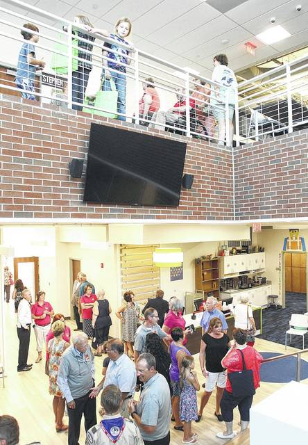People get a look around the new Amos Memorial Public Library addition during its grand opening in Sidney, Wednesday, Aug. 9. For more photos, see Page 5.