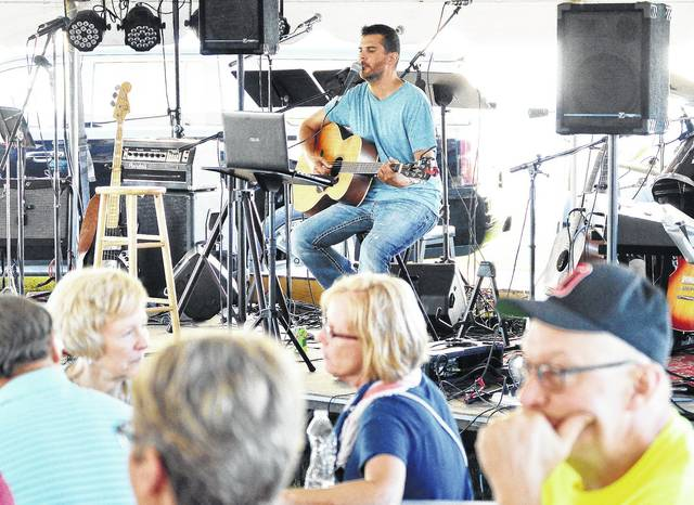 Ohio Mystery Band performs during the Sacred Heart of Jesus Parish Picnic in McCartyville, Saturday, Aug. 12.