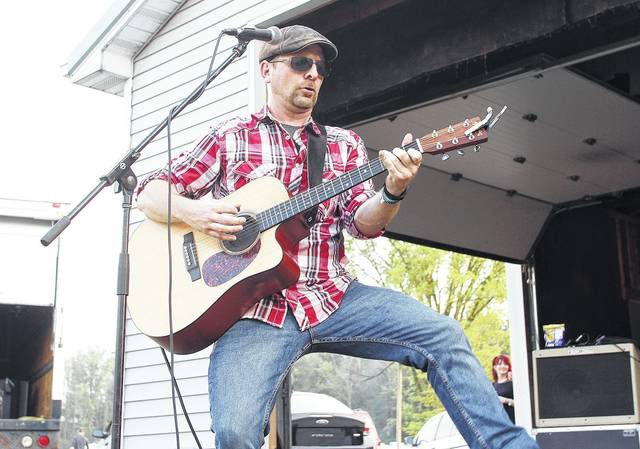 Mark Cantwil does a little dance during his performance at the White Oak Jamboree Friday, Aug. 11.