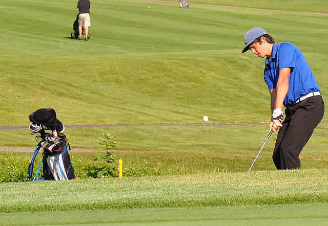 Russia's Will Sherman chips onto the 13th green during the Kendig Memorial Wednesday in Piqua.