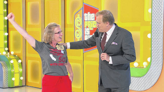 "Terri Berning, of Anna, competed on ""The Price is Right"" on Wednesday, Sept. 27. She won a sauna, designer handbags and a flat screen TV. At the spin-off, she initially tied to go to the finals, but lost during the tie-breaking round. Shown here with ""The Price is Right"" host Drew Carey, Berning jumped for joy when she had the winning bid to get her chance to win a bigger prize."