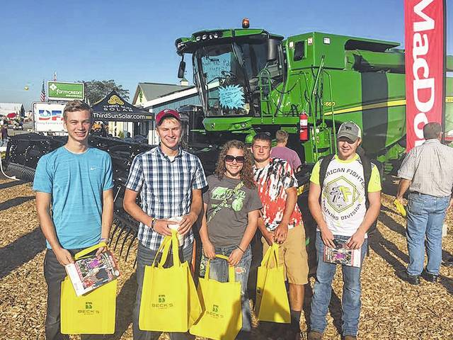 Edison State Community College students Wyatt King, Logan Ressler, Kayla Seman, Andrew Rowland, and Wyatt Baker attend an agriculture tradeshow.