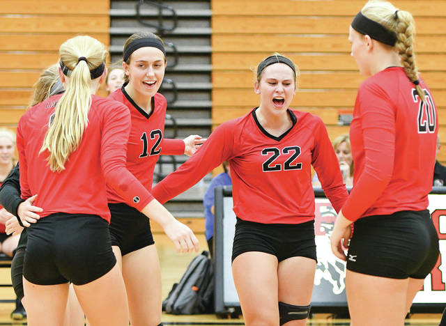 Fort Loramie players celebrate after scoring a point on Thursday against Russia. The Redskins and Raiders are tied for first place in the Shelby County Athletic League.