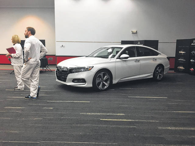Honda engineers stand by a 2018 Accord at the Marysville plant.