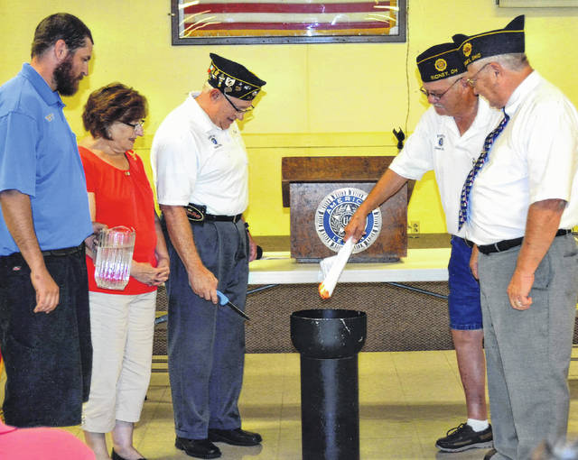 Leaders of the American Legion Post 217 in Sidney participate in a ceremonial burning of the mortgage papers, Sunday, Sept. 24. The mortgage on the building at 1265 Fourth Ave. was retired sooner than members had anticipated, thanks to several unexpected, large donations. Pictured are, left to right, Aaron Stevenson, commander of the Sons of the American Legion; Shelia Nuss, commander of the American Legion Auxiliary; Rick Lunsford, American Legion Debt Retirement Committee chairman; Larry Spence, Post 217 commander and Jim Muhlenkamp, master of ceremonies.