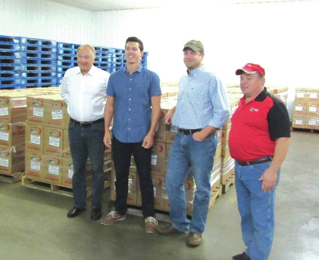 Weaver Eggs President Tim Weaver, left, joined Alex Weaver, left to right, Zach Kohli, and Chuck Jenkins to see the company's egg donation to Hurricane Irma victims being loaded onto a semi-truck trailer Wednesday morning. The shipment will take two days to reach its destination in Florida.