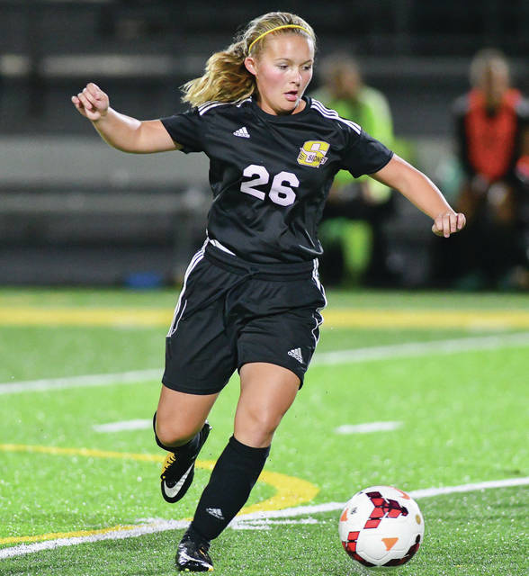 Sidney freshman forward Khia McMillen turns a corner during a Division I sectional final against Troy on Monday at Springfield High School. McMillen scored the game-winning goal for the Yellow Jackets in overtime.