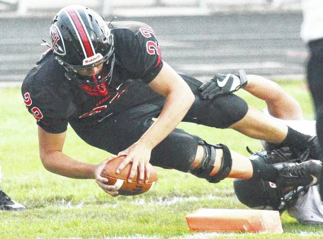 Fort Loramie's Austin Siegel dives into the end zone for a touchdown during a game against Greenon on Sept. 1. Loramie coach Whit Parks said he's pleased with Siegel's performance this season.