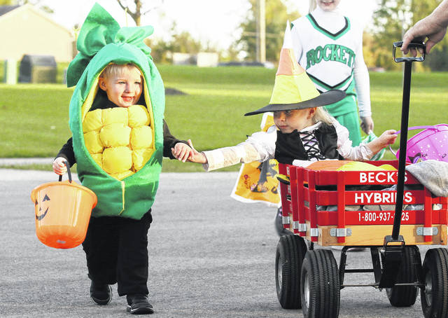 Holding hands while Trick-or-Treating on Ruby Court in Anna Thursday, Oct. 26 are, Cody Barhorst, left, 2, and his cousin Lillian Barhorst, 3, both of Anna. With them dressed as a cheerleader is Cody's sister Avery Barhorst, 7, and pulling the wagon is Craig Barhorst, all of Anna. Cody and Avery are the children of B.J. and Lauren Barhorst. Lillian is the daughter of Craig and Anastasia Barhorst. Trick of treat events planned for Sunday, Oct. 29, include Botkins, 1 to 2:30 p.m.; Jackson Center, 6 to 7 p.m.; village of Maplewood, 5:30 to 6:30 p.m.; Maplewood United Methodist Church, trunk-or-treat, 5:30 to 6:30 p.m.; village of McCartyville, 2 to 4 p.m.; New Bremen, 3 to 6 p.m.; Sacred Heart of Jesus Catholic Church, McCartyville, 3 to 4 p.m.; village of Versailles, 2 to 4 p.m.; Versailles Health Care Center, 2 to 3 p.m. On Tuesday, Oct. 31, trick or treat will be held in Port Jefferson, 6 to 7:30 p.m.; Sidney, 6 to 7:30 p.m.; Tawawa, 6 to 7:30 p.m.; and trunk or treat at Grace Baptist Church, 137 W. Edgewood St., Sidney, 6 to 8 p.m.
