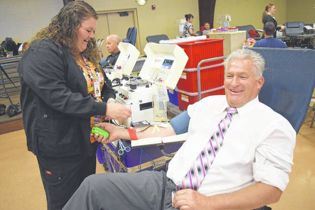 Shelby County Commissioner Tony Barhorst donates blood at St. Michael's Hall fall blood drive.