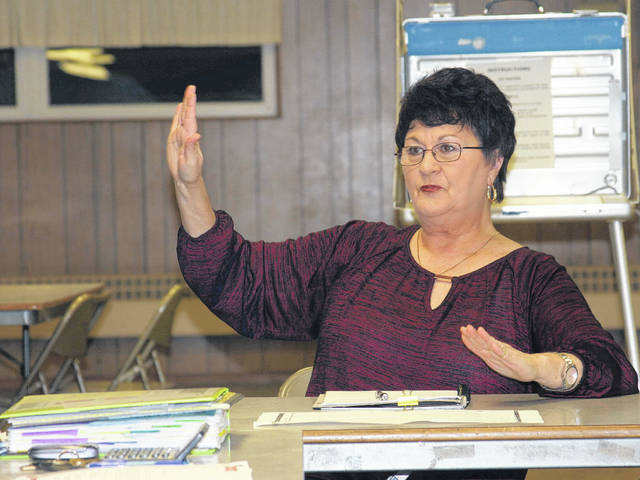 Port Jefferson council member Joan Mader responds to comments from residents about speeding and ignoring stop signs on Canal Street in Port Jefferson.