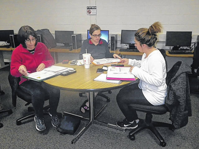 Amy Chupp, of Sidney, center, works in a math study group with Melissa Cain, left, of Sidney, and Jessika Mount, of Urbana, at Edison State Community College, recently. Chupp was one of 32 people to win national scholarships from UCB.
