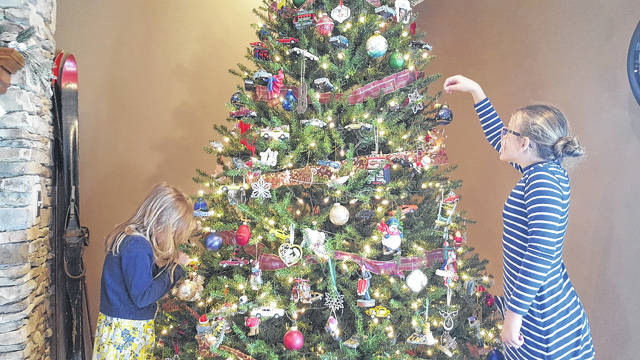 Aspen Brown, 6, and Ella Brown, 9, put the finishing touches on their Christmas tree. Their home is part of the 2017 Botkins Christmas Tour of Homes on Dec. 3. They are the daughters of Craig and Sara Brown.