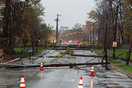 Trees limbs and power lines covered the streets of Celina on Sunday evening after a tornado came through the town.    Levi A. Morman | The Lima News