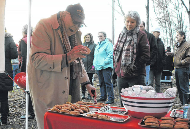 Bob Sargeant, right, grabs a cookie following the groundbreaking ceremony of the Bob Sargeant and Family Shelby County Animal Shelter and Adoption Center, Friday, along Gearhart Road. Sargeant is one of the largest donors to SCARF's campaign for the $2.4 million animal shelter.