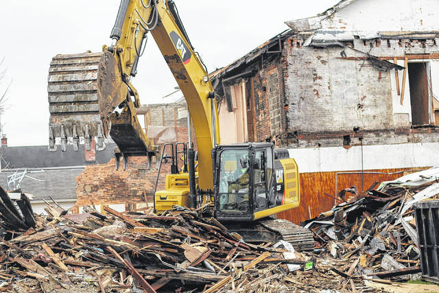 Huelskamp Drainage and Excavation demolishes a multi-unit building, Thursday, Nov. 16, for the Shelby County Land Reutilization Corp., known as the land bank, which celebrates its first anniversary today, Nov. 18. The building was one of 20 derelict structures that the land bank is tearing down this month.