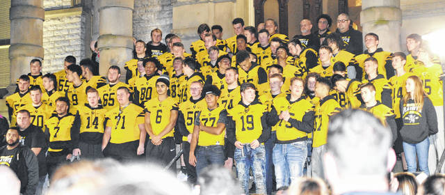 The Sidney High School Yellow Jacket football team leads a pep rally on the courtsquare in downtown Sidney, Thursday, Nov. 2.