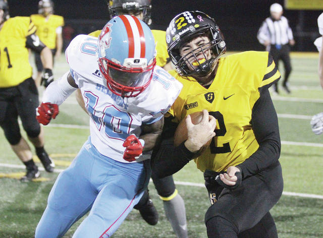 Sidney's Isaiah Bowser, right, collides with Belmont's Donovan Sims during a Division II playoff game at Sidney. Bowser was selected first team all-Ohio.