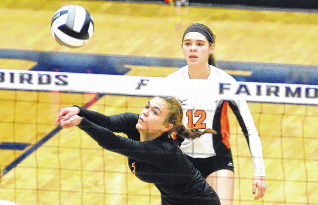 Versailles' Kami McEldowney gets a dig during a regional championship match against Miami East on Saturday at Fairmont's Trent Arena.