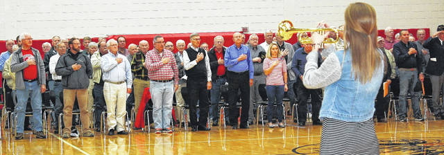 Cassidy Albers, a junior in the Fort Loramie High School Band, plays Taps to conclude a program honoring veterans, standing, at the school, Friday, Nov. 10. For the story, see Page 5.