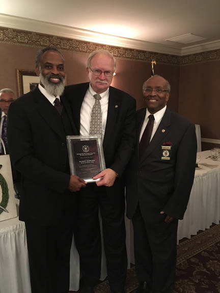 Sidney Mayor Mike Barhorst, center, accepts an award from the Rev. Staccato Powell, left, of Hallsboror, N.C., and Gary Wilson, of Lima, at the Piqua Country Club recently.