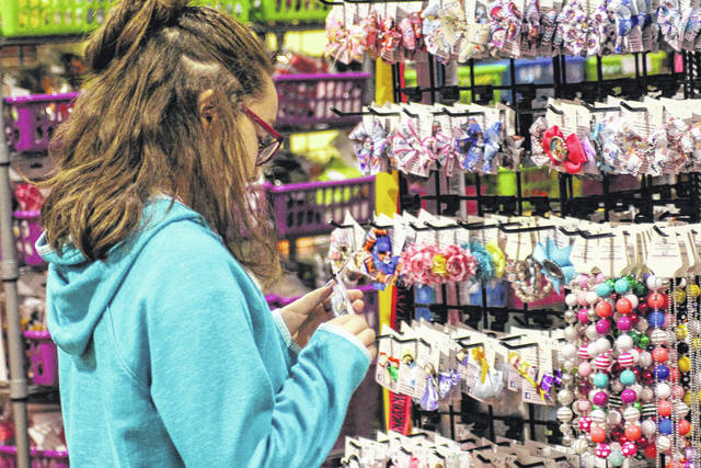 Riley McAlexander, 11, daughter of Danielle McAlexander, of St. Paris, looks at some hair bows during Saturday's Charity League Craft Show held at Lehman Catholic High School in Sidney.