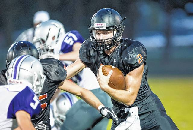 Minster's Jared Huelsman runs the ball during a Midwest Athletic Conference game against Fort Recovery in September at Memorial Field in Minster. Huelsman has rushed for 1,617 yards and 23 touchdowns and thrown for 1,951 yards and 16 touchdowns.
