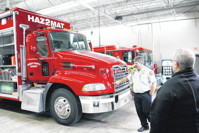 Sidney Assistant Fire Chief Cameron Haller, left, talks to Sidney City Manager Mark Cundiff about the new HazMat 2 vehicle purchased for the Shelby County HazMat Team with state grant funds. The new vehicle was on display during an open house Tuesday, Nov. 7 at the Sidney Fire Department. The new vehicle is a 2005 Mack heavy rescue truck which is replacing the old 1979 International truck which was a converted beverage transportation truck. The truck is a type 2 Hazmat vehicle which is equipped to respond to all hazards except radiological.