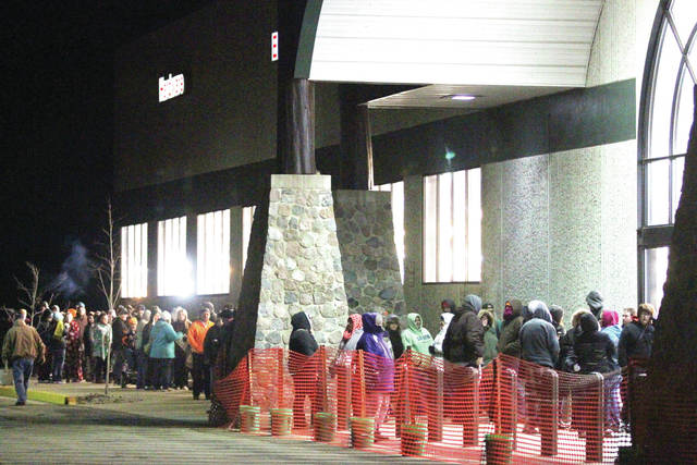 A line of people stretches away from the front doors of the Sidney Menards at 5:30 a.m., Friday, Nov. 24. The people were waiting for the doors to open at 6 a.m. so that they could be among the first to get Black Friday deals.